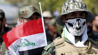 Members of the Shiite militias known as the Popular Mobilisation Units march in Baghdad on July 10.
