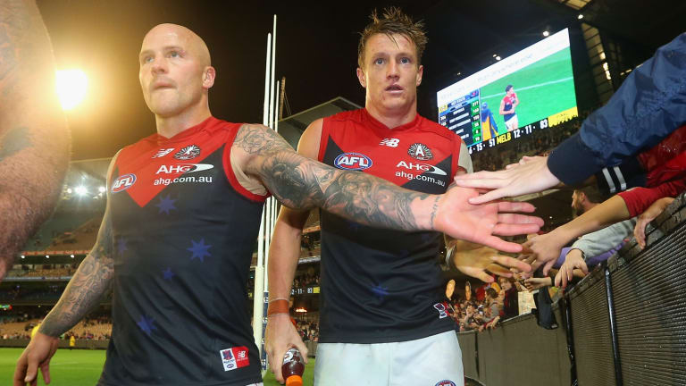 Nathan Jones (left) will lead the Demons again.