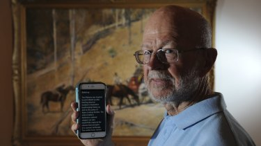 Haydn Daw using the Open Access Tour app to read captioning for the NGA's Tom Roberts' audio tour.