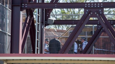 Police continued to examine the scene at Dreamworld on Wednesday.