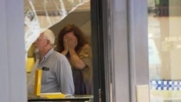 Distressed staff inside the Holloway Diamonds store.
