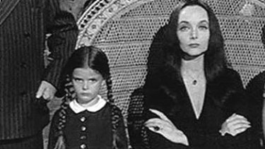 In <i>The Addams Family</i>(1964-1966). TV series. [L-R, behind the chair]: Uncle Fester (Jackie Coogan); Lurch (Ted Cassidy); Grandmama Addams (Blossom Rock). [L-R, front row]: Gomez Addams (John Astin); Wednesday (Lisa Loring); Morticia Addams (Carolyn Jones); Pugsley (Ken Weatherwax).