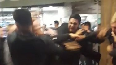 Vision of the wild brawl outside a Melbourne Central bar on Saturday night.