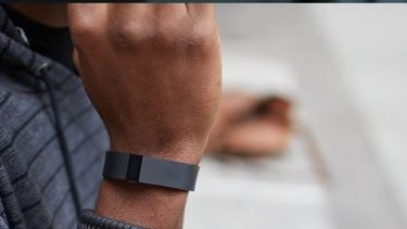 The FitBit Force uses sensors to track your walking and sleeping patterns.