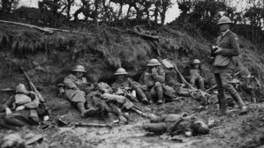 George Hubert Wilkins  stands among the dead and wounded on the Western Front
