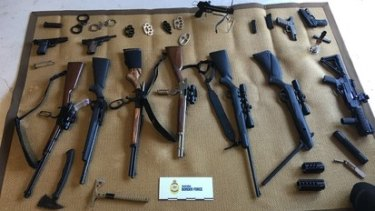 Guns and weapons seized from a property in Queensland.