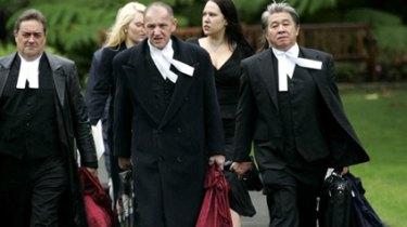 Perth lawyer Tom Percy QC (center).