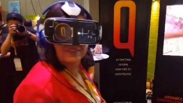 Innovation Minister Leanne Enoch views new tourism destinations with special 3D headgear.