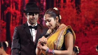 Forbidden love: Nikhil Anand, left, as Devdas and Ila Srivastava, as Paro, in <i>Devdas the Musical</I>.
