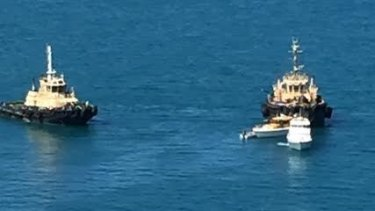 The skipper of a fishing boat died after the vessel upturned off the coast of Bowen.