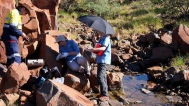 CSIRO field staff taking colour data on the Burrup Peninsula, as published in a CSIRO report.