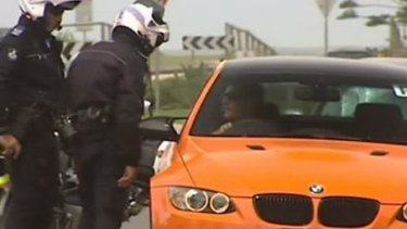Bad boy: Bernard Tomic is pulled over by police.
