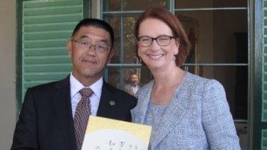 Dr Zhu with prime minister Julia Gillard in February 2013.