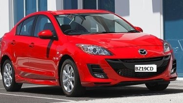 A red Mazda 3 sedan, similar to missing Leeton teacher Stephanie Scott's car.