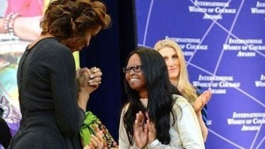 Laxmi meets Michelle Obama at the International Women of Courage Awards in 2014