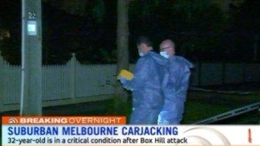 Police investigate the Box Hill carjacking.