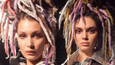 Models Bella Hadid and Kendall Jenner wear fake dreadlocks at Marc Jacobs' NYFW show.