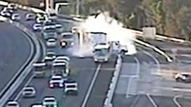 Traffic cameras captured the moment a truck braked heavily to avoid hitting a school bus.