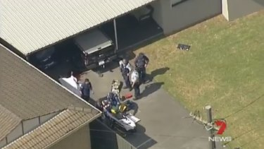Aerial footage from the scene showed the body covered by a white sheet in the driveway.