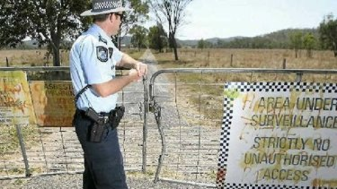 A police officer at the locked gates of the abandoned St Joseph's Orphanage at Neerkol in 2012.