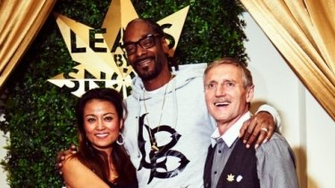 John Lord and his girlfriend, Ling Monk, pictured with rapper Snoop Dogg, who Lord has signed to sell a branded product called Leafs by Snoop.
