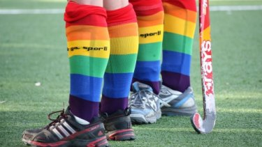 "Hockey players wear rainbow socks during the ""Fair go, sport!"" campaign."