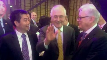 Landbridge head Ye Cheng, Prime Minister Malcolm Turnbull and then trade envoy Andrew Robb in Beijing in April 2016. Three months later, Mr Robb was on Mr Ye's payroll.