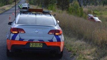 Police at the scene of the crash at Copeton Dam Road.