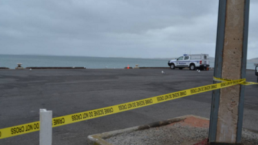 Police cordoned off the area around the Port Lincoln wharf after a car drove off the wharf on Monday.
