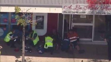 Emergency services treat injured passengers at Moorooka