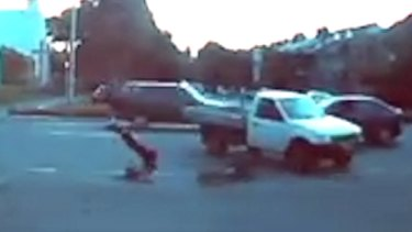 The cyclist tumbles over the vehicle's bonnet.