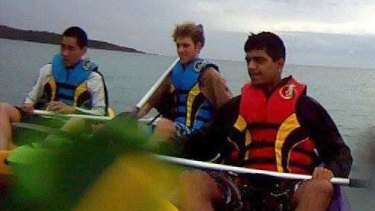 A screenshot of the three men captured kayaking in the GoPro footage.