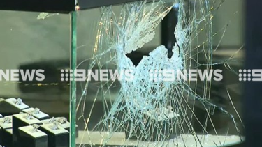 The smashed window of a Canterbury jewellery store after it was robbed on Thursday.