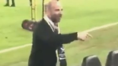 George Calombaris exchanges words with a fan at the A-League grand final.