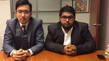 Damir Tulemaganbetov, left, with his friend Mohammed Islam in the office of public relations firm 5WPR.