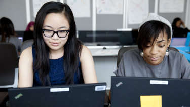 Girls learn to code as part of Girls Who Code.