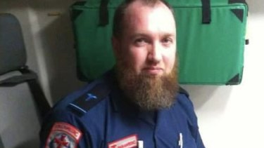Adam Brookman pictured on a Facebook page wearing what appears to be an Ambulance Victoria graduate paramedic uniform..