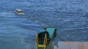 A 4WD rolled off a barge near Fraser Island and into the Great Sandy Strait.