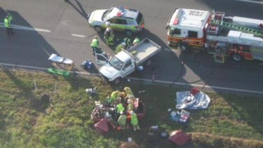 Multiple emergency services crews are at the scene of a head-on crash where three people died near Ipswich in October.