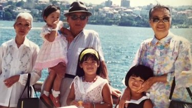 Giselle (front) with her Bà Nội, sister Arielle, paternal grandfather Ông Nội, sister Cybelle, and Bà Ngoại. It was taken in Sydney in 1992.