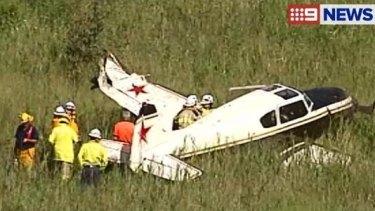 Emergency crews at the scene of a plane crash south of Brisbane.