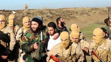 Islamic State militants with captured Jordanian pilot  Muath al-Kasasbeh.