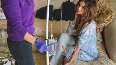 Model Carla DiBello receives an intravenous shot she says 'kills' her jetlag.