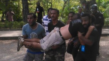 A protester is carried away after the shooting at University of Papua New Guinea on Wednesday.