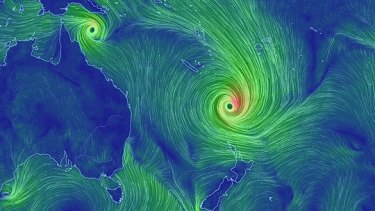 Cyclone Pam as it headed south after slamming Vanuatu, while Cyclone Nathan lingers of the Queensland coast