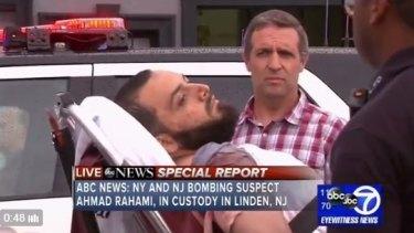 Ahmad Rahami being taken into police custody on a stretcher on Monday.