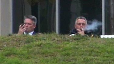 Joe Hockey enjoys a cigar with Mathias Cormann before the 2014 budget was announced.