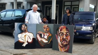 "Australian lawyer Julian McMahon with three self-portraits by Sukumaran: ""The 72 hours just started"", ""Strange Day"" and ""Our new prints: A bad sleep last night""."