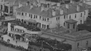 In this photo of the Esplanade Hotel believed to have been taken during a visit to Australia by Prince Albert in 1927, revellers can be seen on the rooftop terrace..