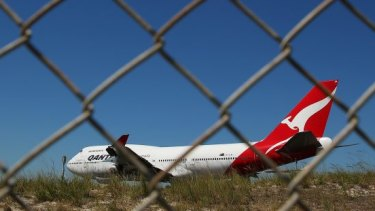A woman reportedly drove through a fence onto a runway at Brisbane Airport.